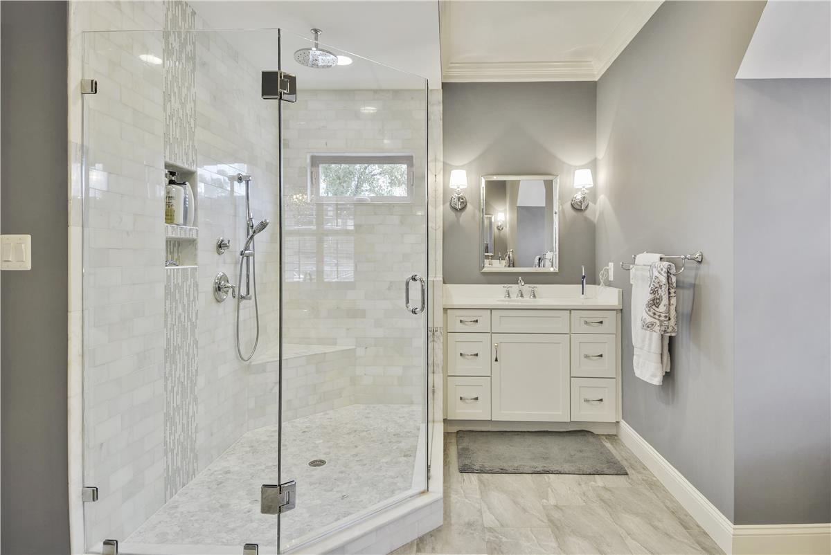 Should You Pick The Same Finishes For All Your Bathrooms? | NDI